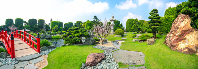 Foto op Plexiglas Tuin Beautiful garden in ecotourism is designed harmony with cypress, pine, stone and ancient trees bearing traditional culture of traditional Japanese gardens.