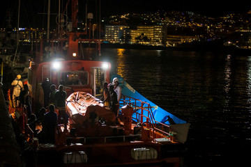 Migrants intercepted off the coast of Gran Canaria arrive aboard a Spanish maritime rescue boat at the port of Arguineguin