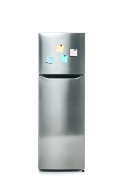 stainless steel fridge with blank sticky notes isolated on white