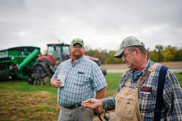 Hodgen and his son Paul stand on their farm in Roachdale