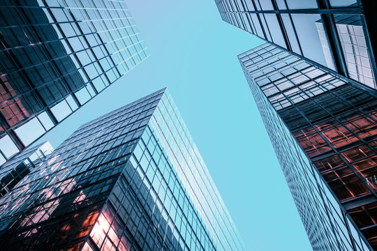 Corporate office building facade and sky - business concept -