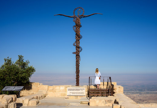 Serpentine Cross at the top of Mount Nebo in Jordan, place where Moses viewed the Holy Land