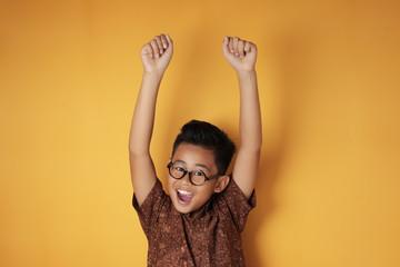 Smart Asian Boy Shows Winning Gesture