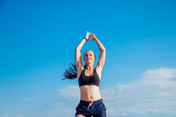 Sports girl is engaged in fitness on the beach