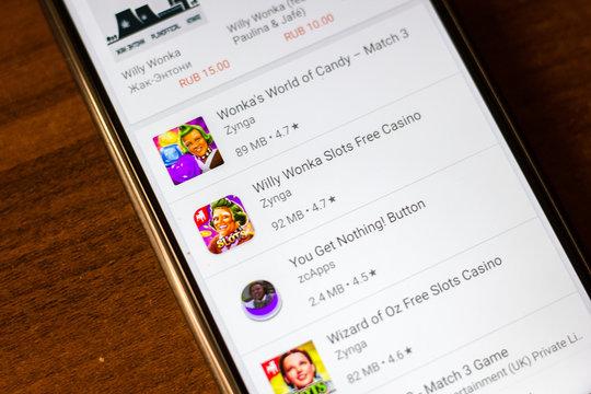 Ivanovsk, Russia - June 26, 2019: Willy Wonka Slots Free Casino app on the display of smartphone.