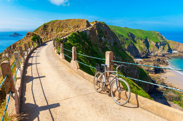 Bicycle parked on Isthmus on Sark Channel Islands UK
