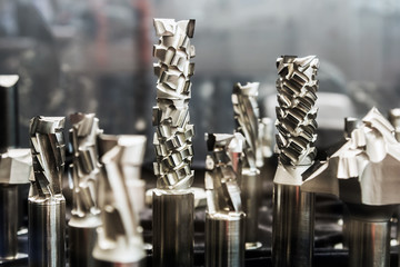 drills on metal of different length and diameter on a shop counter. Shallow depth of field