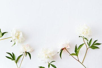 Fotobehang Bloemen Flat lay pattern with white peonies on a white background