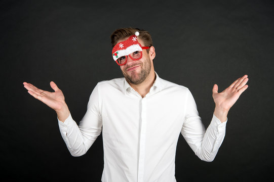 what can i do. handsome man party glasses. santa come for xmas. merry christmas. happy new year. businessman in funny santa claus glasses. corporate party concept. business office party celebration