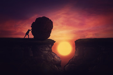 Man found solution in difficult situation, pushing a huge boulder to fill the gap obstacle. Using rock, cover the abyss hole and reach other side of the cliff. Mission accomplishment, overcome concept