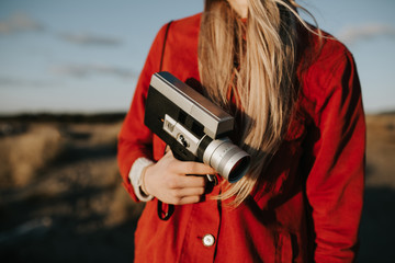 Woman holding with vintage camera