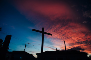 Cross against vivid sunset in the Caribbean islands