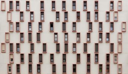 Many narrow windows in facade wall