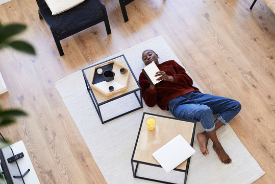 Creative black woman brainstorming at home.