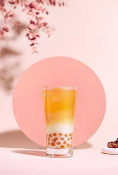 Glass of bubble tea on table