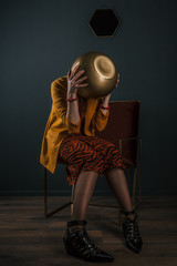 Young woman bizarre fashion portrait