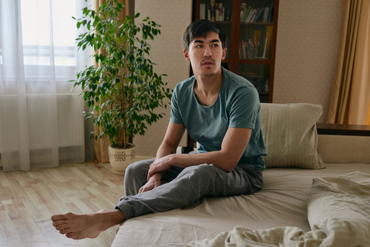Ethnic man sitting on couch in morning time