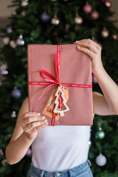 young woman holding red xmas gift