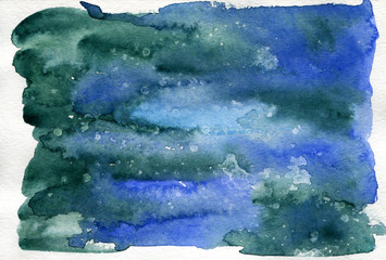 Abstract watercolor painting in blue and dark green