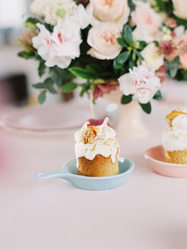 Small delicious cupcakes on table