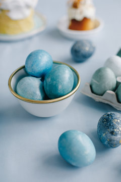 Easter eggs and pastry on a blue background