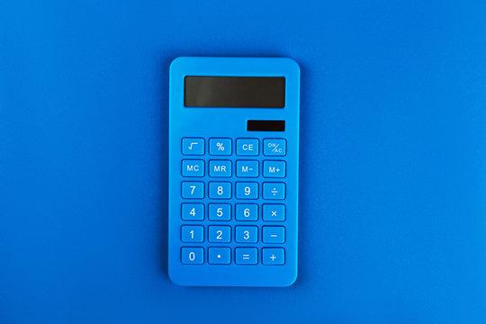 Blue bright calculator on a blue background