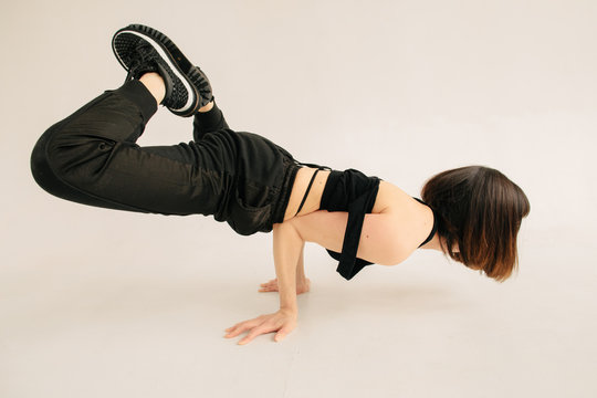 Anonymous female performing breakdance movement
