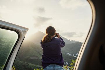 Woman Taking Photos During Roadtrip