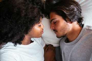 Multiethnic couple in bed.