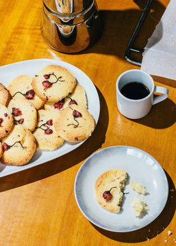 High angle view of cherry blossom cookies with coffee cup on table