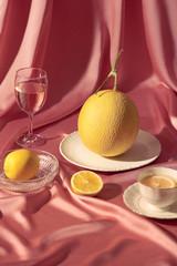 Melon wine and orange tea on table