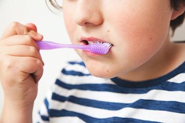 Close up of boy brushing his teeth