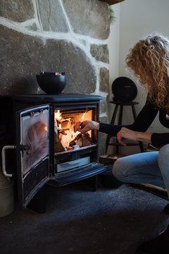 woman builds fire