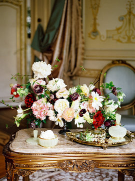 Flower composition on table in classic interior