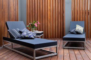 Sun loungers on timber patio