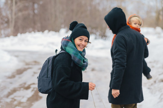 Parents and little boy on winter walk