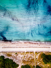 Aerial View From Flying Drone Of Beach Umbrellas with beautiful Water