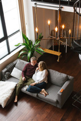 Couple enjoying time together in loft condo home.