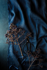 Decorative berries on a blue linen tablecloth