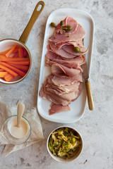 Delicious Corned Beef with sauteed cabbage, carrots, caper berries and sauce.