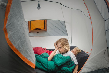 Girl waking up in tent