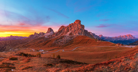 Landscape view of the Italian Dolomites on Passo Giau. Sunset with beautiful blue sky and setting sun.