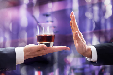 Canvas Prints Bar Hand Rejecting Glass Of Whiskey Offered By Person