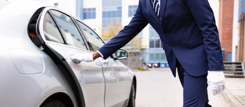 Valet's Hand Opening Car Door