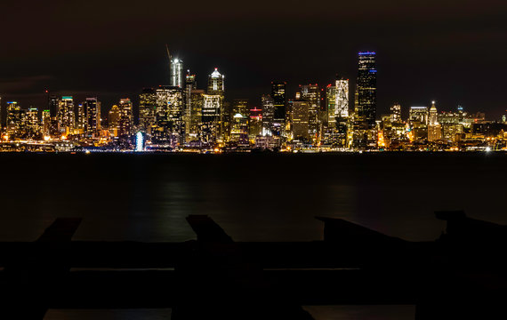 Night Seattle City Skyline with Ferris Wheel overlooking Puget Sound Waters from Seacrest Park, Alki Beach, Don Armeni Boat Launch With old dock in foreground
