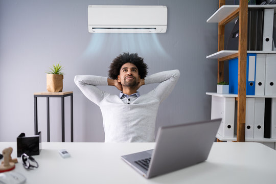 Businessman Working In Office With Air Conditioning