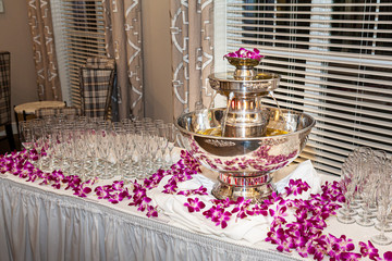 Champagne fountain elegantly displayed on a banquet table with glasses