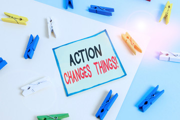Conceptual hand writing showing Action Changes Things. Concept meaning start doing something against problem resolve or achieve it Colored clothespin paper reminder with yellowblue background