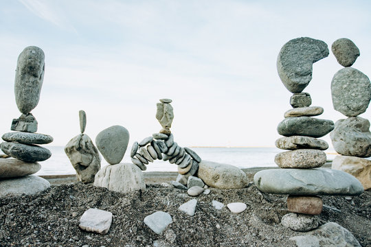 Infinitely stacked stones and stone figures by the sea