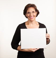 Woman holding up a blank white sign with room for your copy